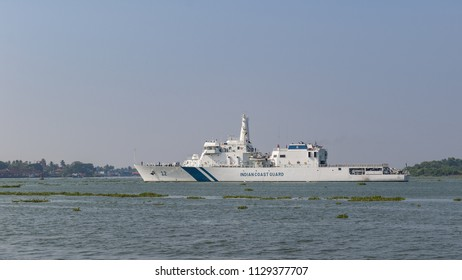 Fort Kochi, India - 16th November 2017: An Indian coastguard vessel exits the bustling port of Cochin, down the Ernakulam Channel