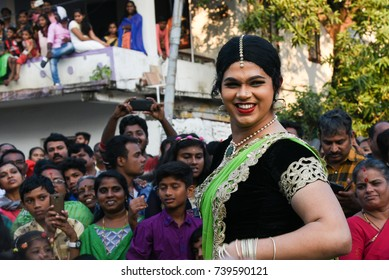 FORT KOCHI, INDIA - JANUARY 01: Man dressed as a beautiful Indian woman at a parade at carnival on Christmas and New year on January 01, 2017 Cochin, Kerala India.