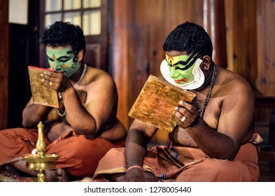 Fort Kochi, Kerala, India, 2019. Two Kathakali artists preparing and applying makeup on self. Kathakali is an Indian classical dance form which is popular in the state of Kerala performed by men.