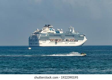 Fort Lauderdale Beach, Florida -USA - February 8, 2021 - Coral Princess luxury vacation Cruise Ship of Princess Cruises port Hamilton Bermuda leaving Florida's Broward County Port Everglades