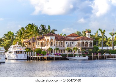 Fort Lauderdale canals. Abbreviated Ft. Lauderdale is known as the Venice of America, due to its extensive and intricate canal system. Yachts moored on canal against cloudy sky at sunset  Las Olas Blv