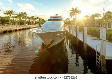 Fort Lauderdale canals. Yachts moored on canal at sunset in Fort Lauderdale. Las Olas Boulevard is the main touristic street and is sorrounded by canals, luxury yachts and amazing residential houses.
