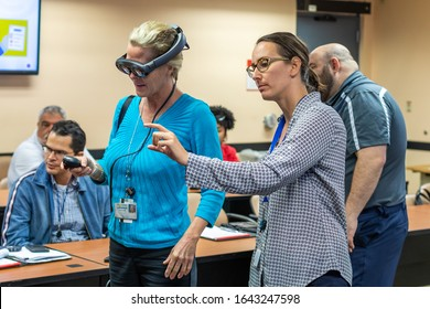 Fort Lauderdale, FL / USA - 2/10/2020: Broward County directors and employee staff wearing Magic Leap 1 augmented mixed virtual reality headsets learning about spatial 3D computing.