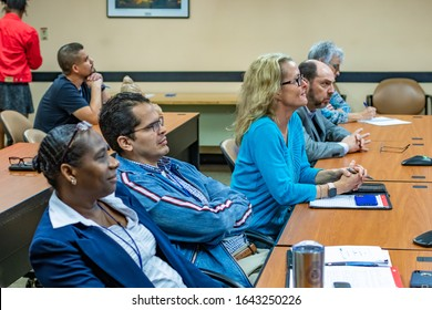 Fort Lauderdale, FL / USA - 2/10/2020: Broward County directors and employee staff learning about Magic Leap 1 augmented mixed virtual reality and spatial 3D computing.