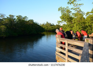 Fort Lauderdale, FL, USA - DECEMBER 25, 2017: Tourists looking to the river at Dr Von D. Mizell-Eula Johnson State Park near Miami, Florida