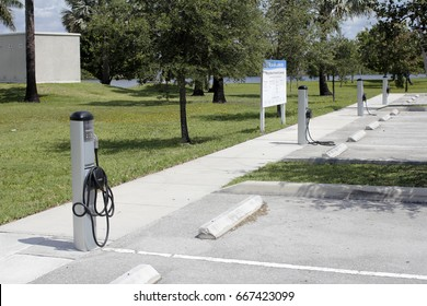Fort Lauderdale, FL, USA - May 16, 2017: Several ChargePoint electronic vehicle charging stations. 4 EV charging stations in a public parking lot on a sunny day