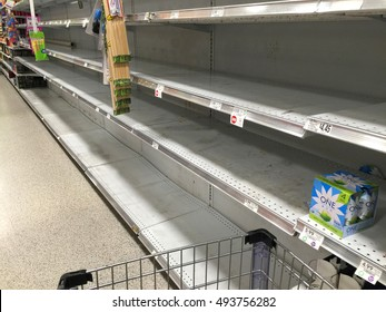 FORT LAUDERDALE, FL, USA - OCTOBER 5, 2016:  Supermarket aisle of bottled water is sold out at a grocery store as residents shop and prepare for Hurricane Matthew, a dangerous category 5 storm.