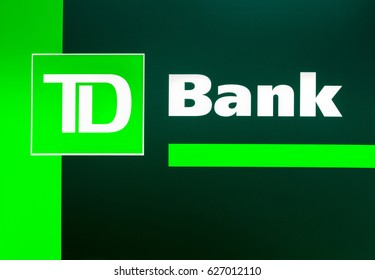 FORT LAUDERDALE, FLA/USA - APRIL 10, 2017: TD Bank exterior sign and logo. TD Bank, N.A., is an Americanl bank chartered and supervised by the federal Office of the Comptroller of the Currency.