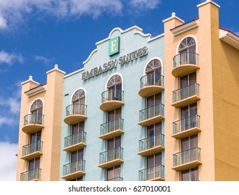 FORT LAUDERDALE, FLA/USA - APRIL 14, 2017: Embassy Suites hotel exterior and logo. Embassy Suites is a chain of all-suite hotels owned by Hilton Worldwide.