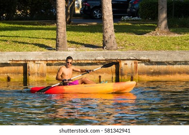 FORT LAUDERDALE, FLORIDA - FEB 5: Young fit man enjoys a day kayaking on the Middle River on 5 Feb 2017 at Fort Lauderdale