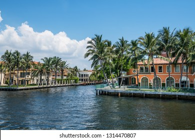 FORT LAUDERDALE, FLORIDA - JULY 14 - Beautiful mansions with palm trees along the canal on July 14 2018 in Fort Lauderdale Florida.
