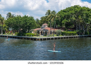 FORT LAUDERDALE, FLORIDA - JULY 14 - Women paddleboarding along the canal on July 14 2018 in Fort Lauderdale Florida