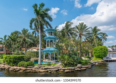 FORT LAUDERDALE, FLORIDA - JULY 14 - A beautiful Oriental gazebo surrounded by palm trees and the canal on July 14 2018 in Fort Lauderdale Florida.