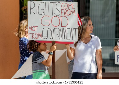 Fort Lauderdale, Florida / USA - 5/12/2020: Protest of the shutdown in front of Broward County Government Center downtown before the commissioner meeting on Covid 19 Coronavirus business re-openings