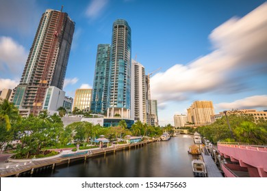 Fort Lauderdale, Florida, USA cityscape and riverwalk on the New River.