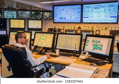 Fort Lauderdale, Florida / USA - December 6, 2012: Man watches over large computer screens controlling major functions of large cruise ship.