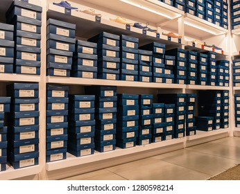 Fort Lauderdale, Florida, USA - January 08, 2019 : Interior of famous shoe brand Cole Haan USA store focused on shoe boxes and shoes on the shelves.