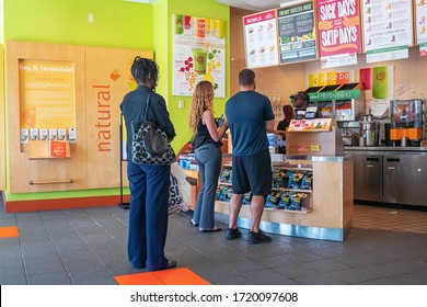 Fort Lauderdale, Florida, USA - January 07, 2019: Inside of Jamba Juice store when people in the line to buy juice or smoothies.