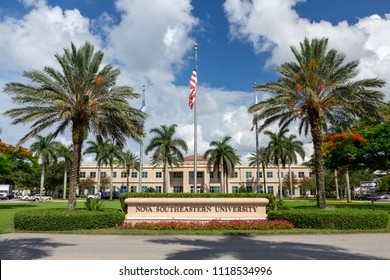 FORT LAUDERDALE, FLORIDA, USA - JUNE 22, 2018: Nova Southeastern University, main campus entrance sign with flags