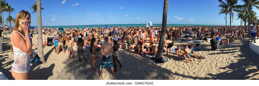 FORT LAUDERDALE, FLORIDA, USA - MARCH 6: Thousands of college students enjoy beautiful weather at Fort Lauderdale Beach at their annual mid-semester college break as seen on March 6, 2018.