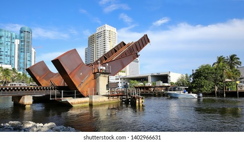 FORT LAUDERDALE, FLORIDA, USA - MAY:  Florida East Coast (FEC) Railway Bridge goes up to allow boats to pass underneath.  When closed the bridge has 4 feet of clearance, as seen on May 17, 2019.