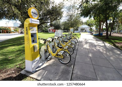 Fort Lauderdale, Florida / USA - November 28 2018: AvMed Rides rental Trek bicycle stand and bikes with basket at Esplanade Park on Himmarshee SW 2nd Street near the Museum of Discovery Science, river