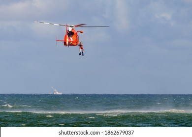 Fort Lauderdale, Florida, USA - November 21, 2020: United States Coast Guard airplane, helicopter, boats, officer rescue diver watercraft and military ocean safety hardware demo at air and sea show.