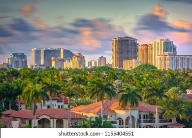 Fort Lauderdale, Florida, USA skyline and houses at dusk.