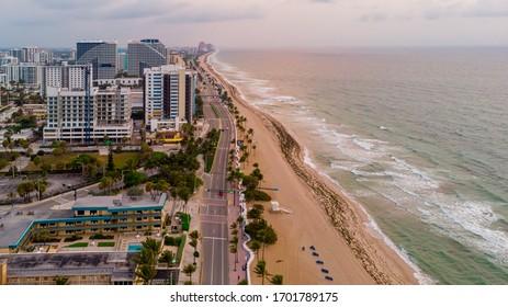 Fort Lauderdale. Florida/USA - April 12, 2020: Aerial View on Fort Lauderdale coast line, public beach and Atlantic Ocean at sunrise.