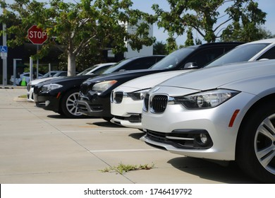 FORT LAUDERDALE, FLORIDA/USA - MAY 31 2020 - Different color BMWs line up the parking lot in the afternoon sun at the dealership on 2601 S. Andrews Avenue