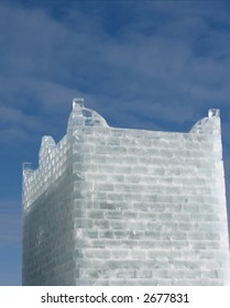 A fort made from ice blocks against a blue sky.