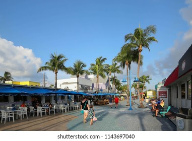FORT MYERS BEACH, FL, USA - JULY:  Tourists and locals enjoying the ambiance of Time Square, a popular tourist destination, considered the center of Fort Myers Beach,  as seen on July 26, 2018.