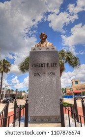 Fort Myers, Florida, USA – June 7, 2018: Clouds form in a blue sky above the controversial Robert E. Lee monument in downtown Fort Myers, Florida. Editorial use only.