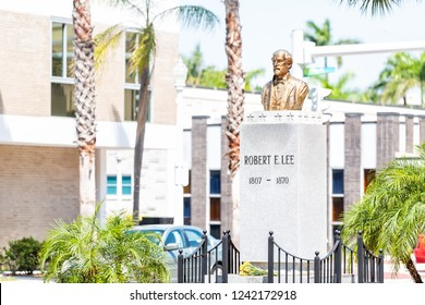 Fort Myers, USA - April 29, 2018: City town street during sunny day in Florida gulf of mexico coast, Robert E Lee statue memorial bust sculpture