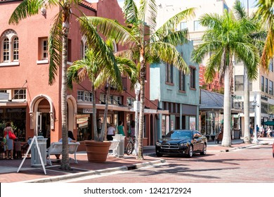 Fort Myers, USA - April 29, 2018: City town street during sunny day in Florida gulf of mexico coast, shopping, restaurants