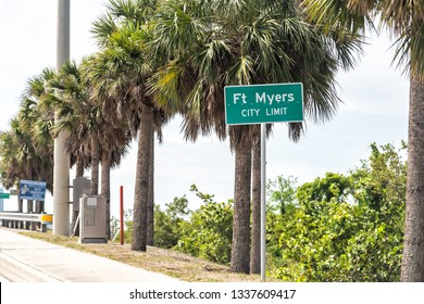 Fort Myers, USA - April 29, 2018: Town street during sunny day in Florida gulf of mexico coast with sign closeup for city limit on highway road and palm trees lined