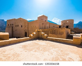 Fort Nakhl, or Husn Al Heem, fortress, over Nakhl Oasis on Jebel Nakhl massif, historical clay building, Al-Batinah province, Sultanate of Oman, Gulf, Arabian Peninsula, Middle East, Asia, Oct 2015