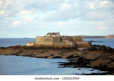Fort National - fortress on tidal island Petit Be in Saint-Malo. Fort was built in 17th century to protect city. Saint-Malo is a port city in Brittany in France on English Channel