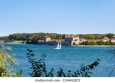 Fort Niagara USA on the Niagara River from the Candian side with a day sailer