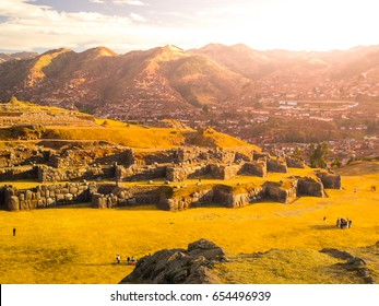 Fort Sacsayhuaman and Cuzco city on backgroudn on sunny day, Peru.