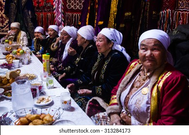 Fort Shevchencko, Mangystau/Kazakhstan   March 22 2015: Traditional celebration of Navruz, the spring festival. Local women eating and waiting for presents.