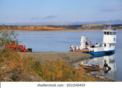 Fort Simpson, Northwest-Territories/Canada - Sept-19-2017: Ferry over the Mackanzie River waiting for vehicles. This is the one and only road connection between Fort Simpson and Wigley.