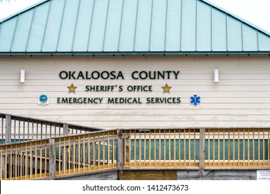 Fort Walton Beach, USA - April 24, 2018: Okaloosa Island county Sheriff's Office emergency medical services building with sign by beach by ramp in Florida Panhandle, Gulf of Mexico