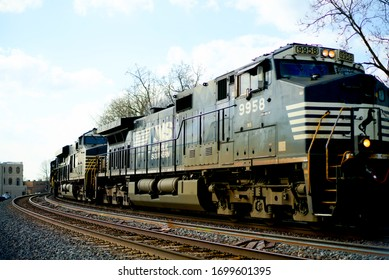 Fort Wayne, Indiana/USA - April 7 2020 - Norfolk Southern Locomotive 9958 Rounds a Curve near Berry and South Hanna Streets, Fort Wayne, Indiana