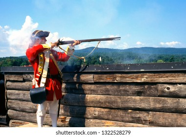 Fort William Henry, Lake George Village, Warren County, New York, USA, living history British Soldier with musket, September 3, 1996