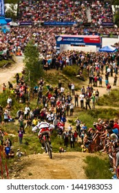 FORT WILLIAM, SCOTLAND - JUNE 6, 2010. Steve Peat (GBR) racing for Santa Cruz Syndicate team at the UCI World Cup Mountain Bike Downhill event. Arriving at finish line with crowds of spectators.