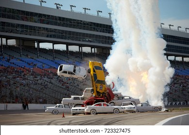 Fort Worth, Texas, USA - June 7th 2013 - Izod Indycar Series Texas Motor Speedway - Stunt car driver Spanky Spangler Jr crashes through an 8 car pyramid before the Firestone 550.