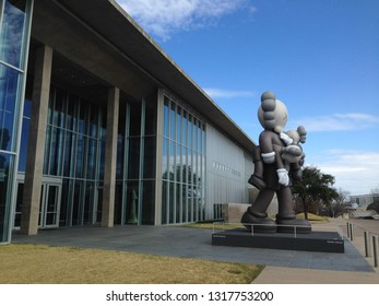 Fort Worth, Texas/USA. February 17th, 2018. Exterior of the Modern Art Museum in Fort Worth, Texas. A sculpture of the mouse Companion by the artist KAWS stand in front of the museum.