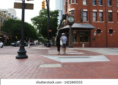 Fort Worth, TX / US - May 2018: Couple walking in downtown Fort Worth Sundance Square