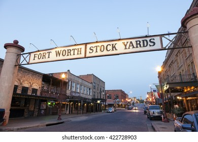 FORT WORTH, TX, USA - APR 6, 2016: Street in the Fort Worth Stockyards historic district illuminated at dusk. Texas, United States